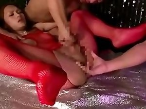 Guy fucks Asian shemale in red pantyhose