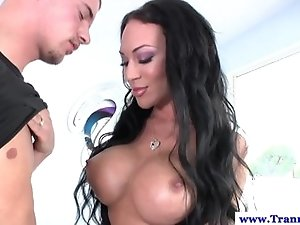 Busty transsexual helps guy masturbate